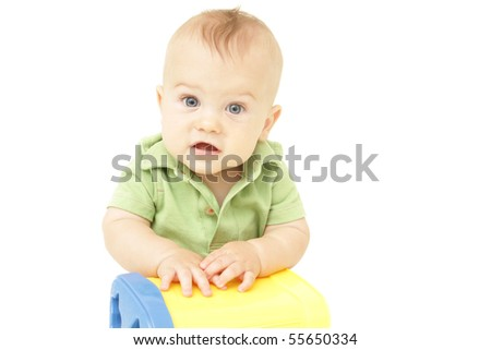 Adorable Baby Boy sitting, on white background, playing