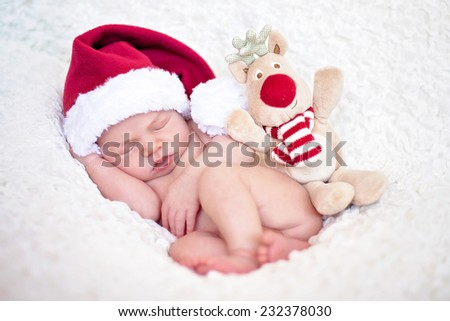 Adorable baby boy, sleeping with santa hat - stock photo