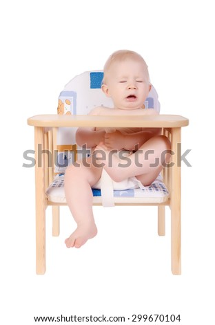 Adorable baby boy sneeze on his chair isolated on white - stock photo