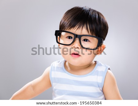 Adorable baby boy wearing glasses - stock photo