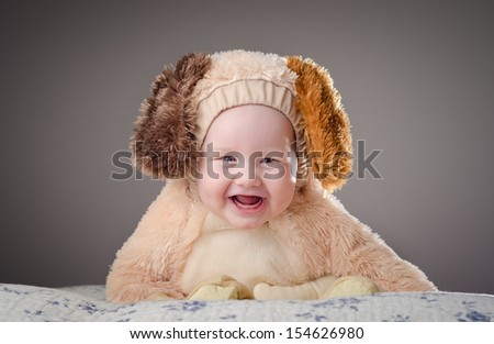 Adorable baby boy with a dog puppy costume. High definition image.  - stock photo