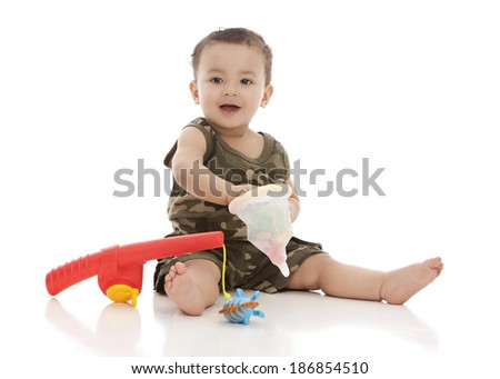 Adorable baby boy with a toy fishing pole and net.  Isolated on white.  Room for your text. - stock photo