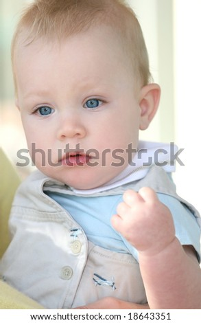 Adorable baby boy with blue eyes - stock photo