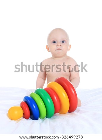 Adorable baby boy with toy on blanket on a white background