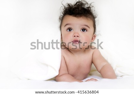 adorable baby boy wrapped with blanked on white background - stock photo