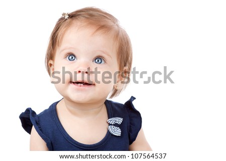 Adorable baby, caucasian, blonde and with stunning blue eyes. The girl is isolated on white.