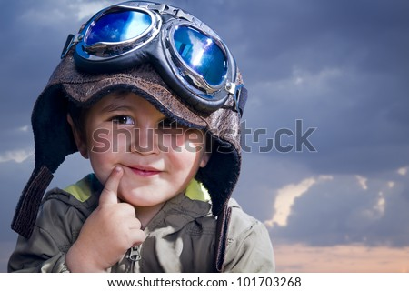 Adorable baby dressed in pilot uniform with funny face - stock photo