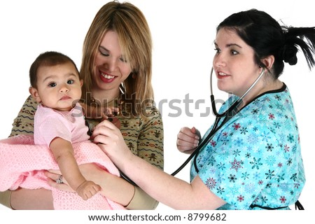 Adorable baby girl getting healthcare check-up. - stock photo