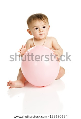 Adorable baby girl holding a large, pink balloon.  Isolated on white.