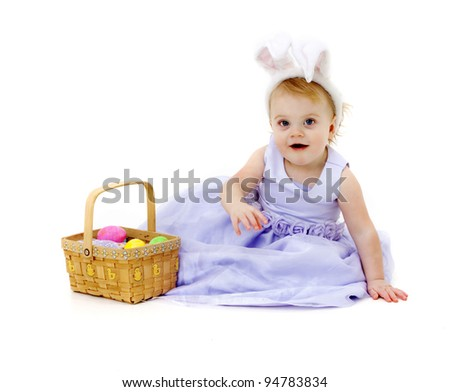 Adorable baby girl in Easter dress and bunny ears - stock photo