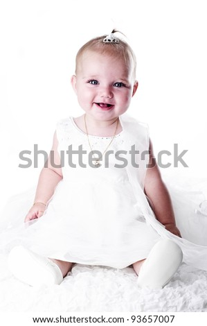 adorable baby girl in white dress