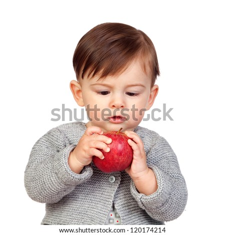 Adorable baby girl looking a red apple isolated on white background - stock photo