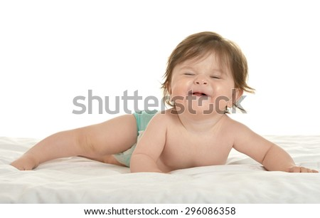 Adorable baby girl lying in pampers on a white background - stock photo