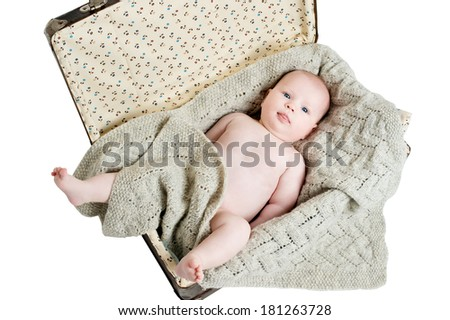 Adorable baby girl lying, isolated white background.