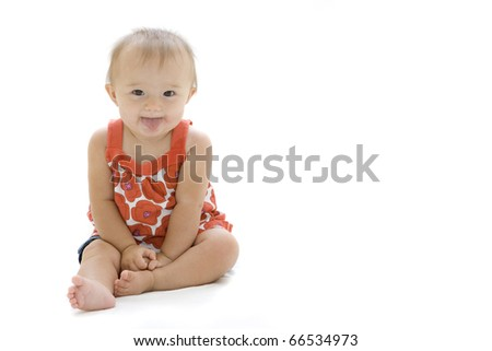 Adorable baby girl making funny faces - stock photo