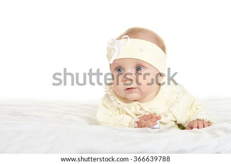 Adorable baby girl on blanket - stock photo
