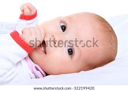 Adorable baby girl on blanket on a white background - stock photo