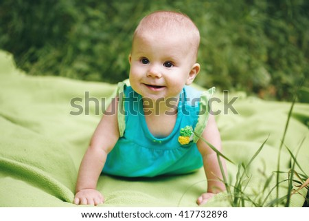 Adorable Baby Girl Playing and Having Fun - stock photo