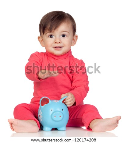 Adorable baby girl sitting with a blue piggy-bank isolated on white background - stock photo