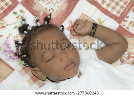 Adorable baby girl sleeping in her room (one year old)   Adorable baby girl sleeping in her room (one year old)  - stock photo