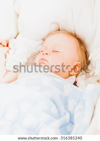 Adorable  baby girl sleeps in her cradle. she is 11 month old - stock photo