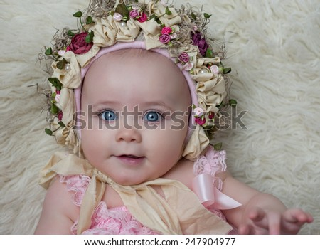 Adorable Baby Girl Wearing Flower Hat