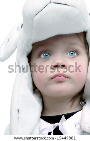 Adorable baby girl wearing fuzzy hat with bright blue eyes