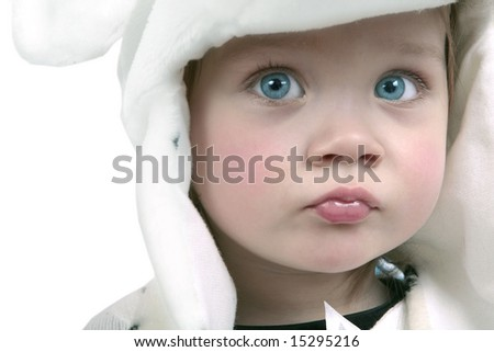 Adorable baby girl wearing white fuzzy hat