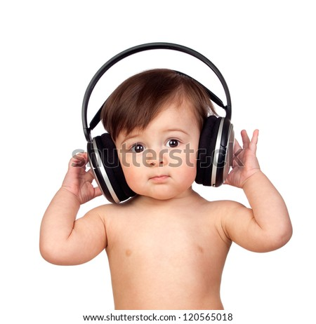 Adorable baby girl with big headphones isolated on white background - stock photo