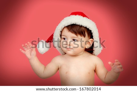 Adorable baby girl with Christmas hat on a red background - stock photo