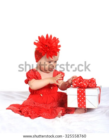 Adorable baby girl  with gifts  on a white background - stock photo