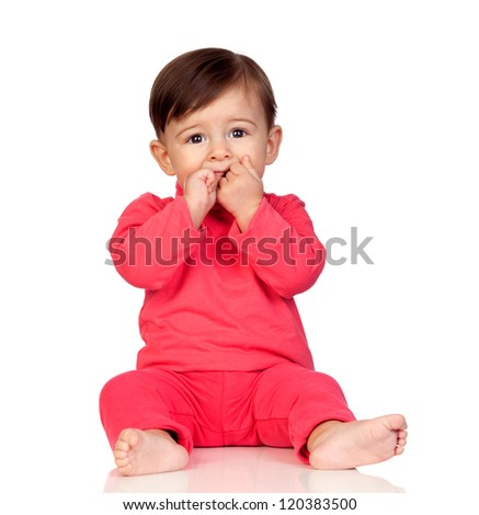 Adorable baby girl with her hand in mouth isolated on white background - stock photo