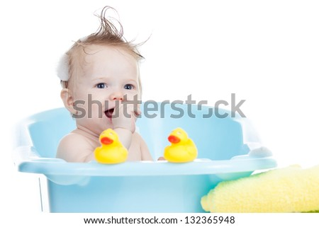 adorable baby having bath in blue tub - stock photo