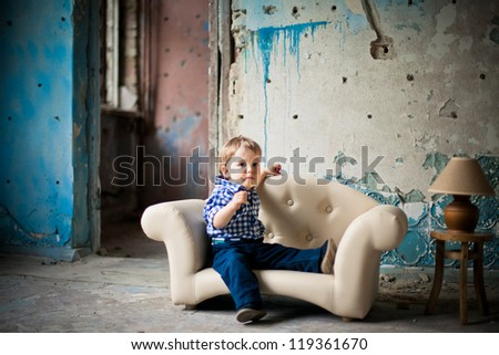 Adorable baby in the chair - stock photo
