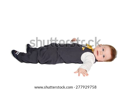 adorable baby lying down, wearing classic vest and colorful bowtie on white background - stock photo