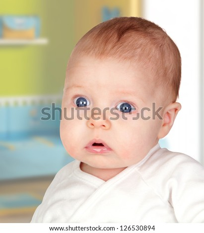 Adorable baby newborn in his bedroom