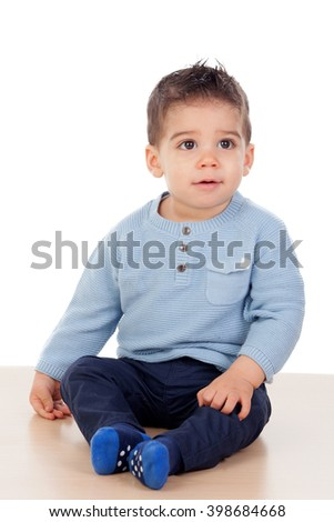 Adorable baby nine months sitting on the floor - stock photo