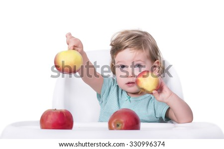 Adorable baby offering apples, healthy food concept - stock photo