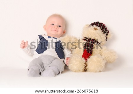 Adorable baby on a white background with his friend - stock photo