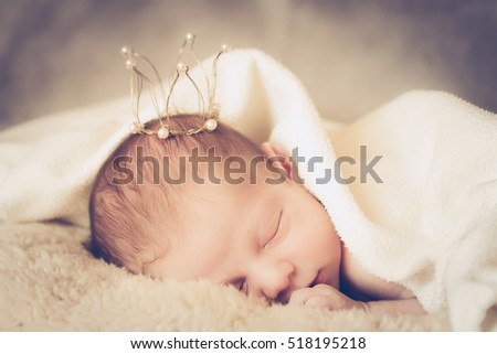 adorable baby princess with golden crown, newborn photography, soft focus