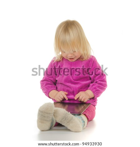 Adorable baby sit with tablet computer on white background