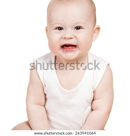 Adorable baby sitting and looking aside over white background. Portrait of naked happy little baby boy sitting on the floor isolated on white background. Studio portrait. - stock photo