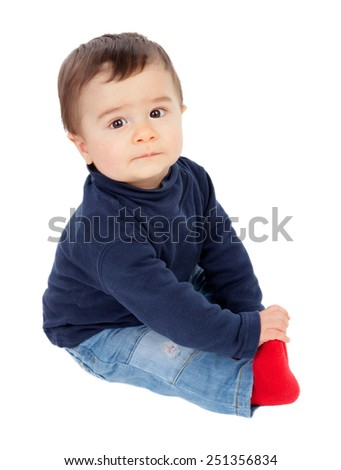 Adorable baby sitting on the floor isolated on a white background