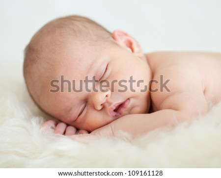 adorable baby sleeping on stomach - stock photo