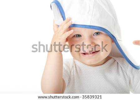 Adorable baby trying on baseball cap that is way too big for him - stock photo