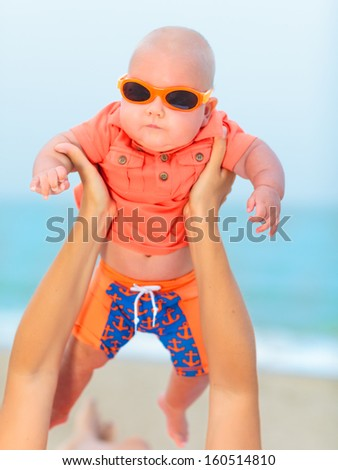 Adorable baby wearing sunglasses