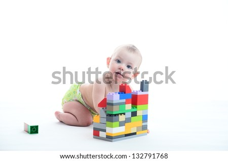 Adorable baby with blocks on white - stock photo