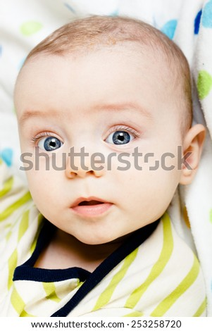 Adorable baby with blue eyes. studio photo - stock photo