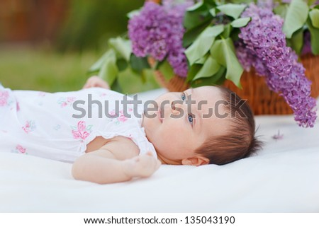 Adorable baby with lilac - stock photo