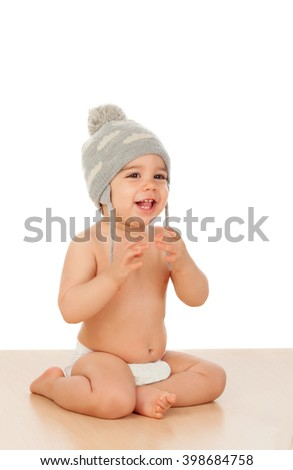 Adorable baby with wool cap isolated on a white background - stock photo